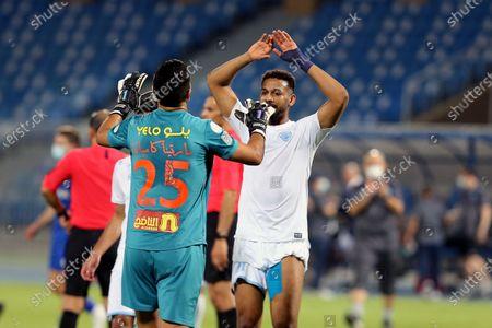 Al-Batin's goalkeeper Martin Campana (L) celebrate with teammate Zakaria Al-Sudani (R) after the end of the Saudi Professional League soccer match between Al-Hilal and Al-Batin at Prince Faisal Bin Fahd Stadium, Riyadh, Saudi Arabia, 14 May 2021.