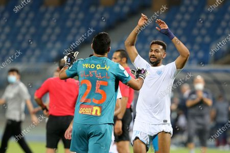 Stock Photo of Al-Batin's goalkeeper Martin Campana (L) celebrate with teammate Zakaria Al-Sudani (R) after the end of the Saudi Professional League soccer match between Al-Hilal and Al-Batin at Prince Faisal Bin Fahd Stadium, Riyadh, Saudi Arabia, 14 May 2021.