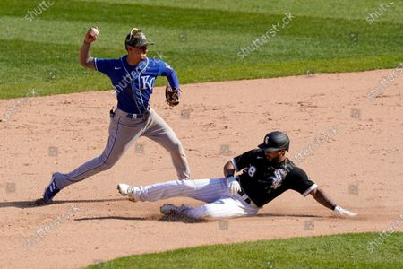 Kansas City Royals' Nicky Lopez turns the double play after forcing out Chicago White Sox's Leury Garcia at second and getting Nick Madrigal at first in the seventh inning first baseball game of a doubleheader, in Chicago