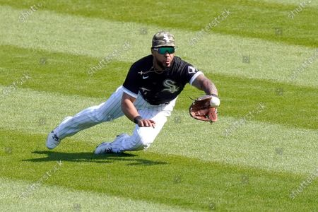 Chicago White Sox's Leury Garcia makes a diving catch on a shallow fly ball from Kansas City Royals' Whit Merrifield in the seventh inning of the first baseball game of a doubleheader, in Chicago