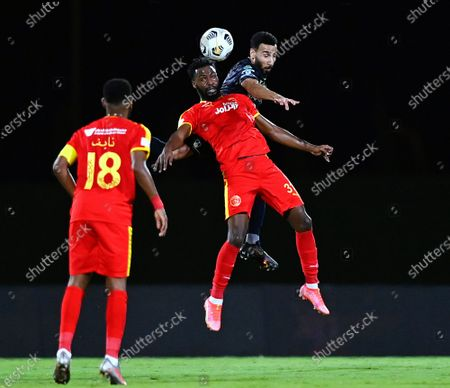 Al-Ahli's player Nouh Al-Mousa (up-back) in action against Al-Qadisiyah's Waleed Al-Shangeati (up-front) during the Saudi Professional League soccer match between Al-Ahli and Al-Qadisiyah at Sport Hall Stadium in King Abdullah Sport City, Jeddah, Saudi Arabia, 14 May 2021.