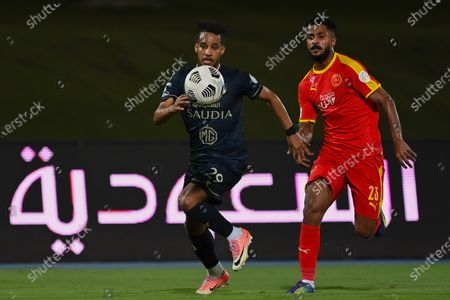 Al-Ahli's player Abdulrahman Ghareeb (L) in action against Al-Qadisiyah's Ibrahim Al-Sheail (R) during the Saudi Professional League soccer match between Al-Ahli and Al-Qadisiyah at Sport Hall Stadium in King Abdullah Sport City, Jeddah, Saudi Arabia, 14 May 2021.