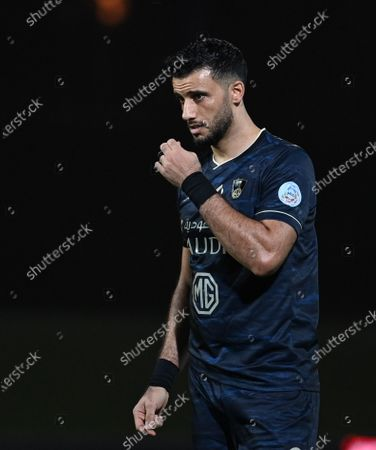 Al-Ahli's player Omar Al-Somah reacts during the Saudi Professional League soccer match between Al-Ahli and Al-Qadisiyah at Sport Hall Stadium in King Abdullah Sport City, Jeddah, Saudi Arabia, 14 May 2021.