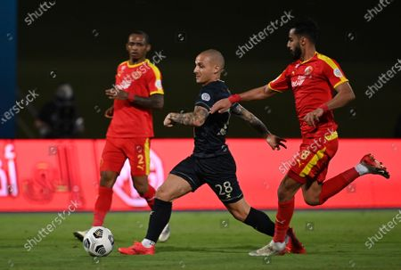 Al-Ahli's player Alexandru Mitrita (C) in action against Al-Qadisiyah's Abdulrahman Al-Safri (R) during the Saudi Professional League soccer match between Al-Ahli and Al-Qadisiyah at Sport Hall Stadium in King Abdullah Sport City, Jeddah, Saudi Arabia, 14 May 2021.