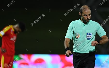 Saudi referee Turki Al Khudair checks his watch during the Saudi Professional League soccer match between Al-Ahli and Al-Qadisiyah at Sport Hall Stadium in King Abdullah Sport City, Jeddah, Saudi Arabia, 14 May 2021.