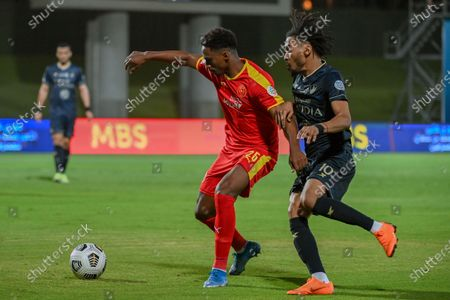 Al-Ahli's player Salman Al-Muwashar (R) in action against Al-Qadisiyah's Khalifah Aldawsari (R) during the Saudi Professional League soccer match between Al-Ahli and Al-Qadisiyah at Sport Hall Stadium in King Abdullah Sport City, Jeddah, Saudi Arabia, 14 May 2021.