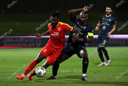 Al-Ahli's player Motaz Hawsawi (R) in action against Al-Qadisiyah's Waleed Al-Shangeati (L) during the Saudi Professional League soccer match between Al-Ahli and Al-Qadisiyah at Sport Hall Stadium in King Abdullah Sport City, Jeddah, Saudi Arabia, 14 May 2021.