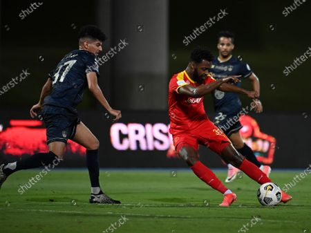 Al-Ahli's player Abdulbaset Al-Hindi (L) in action against Al-Qadisiyah's Waleed Al-Shangeati (R) during the Saudi Professional League soccer match between Al-Ahli and Al-Qadisiyah at Sport Hall Stadium in King Abdullah Sport City, Jeddah, Saudi Arabia, 14 May 2021.