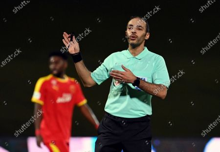 Saudi referee Turki Al Khudair gestures during the Saudi Professional League soccer match between Al-Ahli and Al-Qadisiyah at Sport Hall Stadium in King Abdullah Sport City, Jeddah, Saudi Arabia, 14 May 2021.