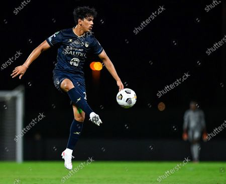 Al-Ahli's player Abdullah Hassoun in action during the Saudi Professional League soccer match between Al-Ahli and Al-Qadisiyah at Sport Hall Stadium in King Abdullah Sport City, Jeddah, Saudi Arabia, 14 May 2021.