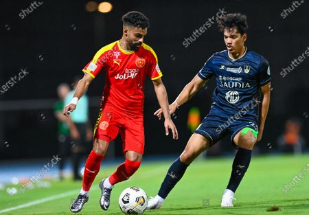 Al-Ahli's player Abdullah Hassoun (R) in action against Al-Qadisiyah's Hassan Al-Amri (L) during the Saudi Professional League soccer match between Al-Ahli and Al-Qadisiyah at Sport Hall Stadium in King Abdullah Sport City, Jeddah, Saudi Arabia, 14 May 2021.