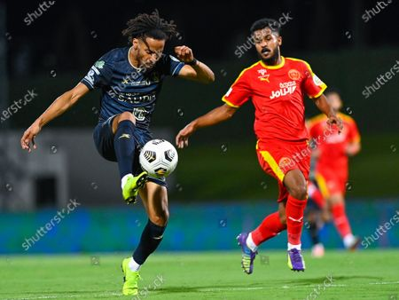 Al-Ahli's player Salman Al-Muwashar (L) in action against Al-Qadisiyah's Ibrahim Al-Sheail (R) during the Saudi Professional League soccer match between Al-Ahli and Al-Qadisiyah at Sport Hall Stadium in King Abdullah Sport City, Jeddah, Saudi Arabia, 14 May 2021.