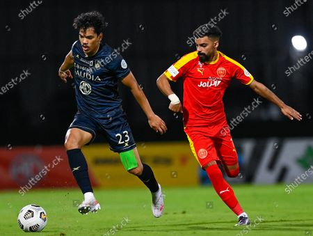 Al-Ahli's player Abdullah Hassoun (L) in action against Al-Qadisiyah's Hassan Al-Amri (R) during the Saudi Professional League soccer match between Al-Ahli and Al-Qadisiyah at Sport Hall Stadium in King Abdullah Sport City, Jeddah, Saudi Arabia, 14 May 2021.
