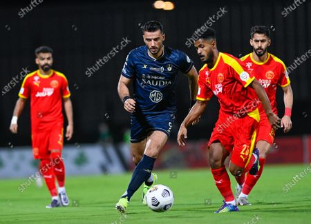 Al-Ahli's player Omar Al-Somah (2-L) in action against Al-Qadisiyah's Ibrahim Al-Sheail (2-R) during the Saudi Professional League soccer match between Al-Ahli and Al-Qadisiyah at Sport Hall Stadium in King Abdullah Sport City, Jeddah, Saudi Arabia, 14 May 2021.