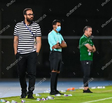 Al-Qadisiyah's coach Yousef Al-Mannai (L) during the Saudi Professional League soccer match between Al-Ahli and Al-Qadisiyah at Sport Hall Stadium in King Abdullah Sport City, Jeddah, Saudi Arabia, 14 May 2021.