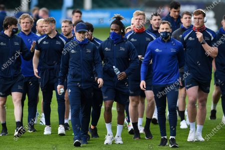 Marland Yarde and other Sale Sharks players look on prior to the match