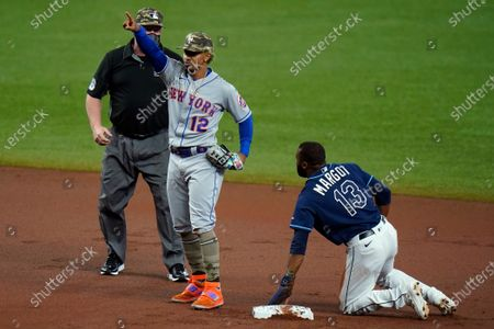New York Mets shortstop Francisco Lindor (12) reacts after tagging out Tampa Bay Rays' Manuel Margot (13) attempting to steal second base during the first inning of a baseball game, in St. Petersburg, Fla
