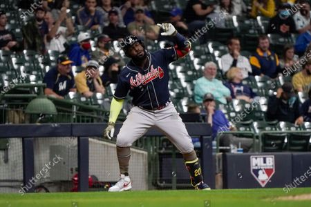 Atlanta Braves' Marcell Ozuna pauses at third after hitting a home run during the fifth inning of a baseball game against the Milwaukee Brewers, in Milwaukee