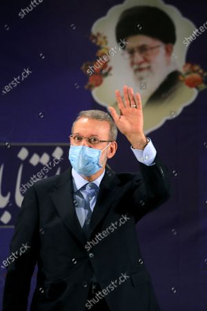 Former Iranian parliament speaker Ali Larijani attends a news conference after registering his candidacy for the June 18 presidential elections at the elections headquarters of the Interior Ministry in Tehran, Iran