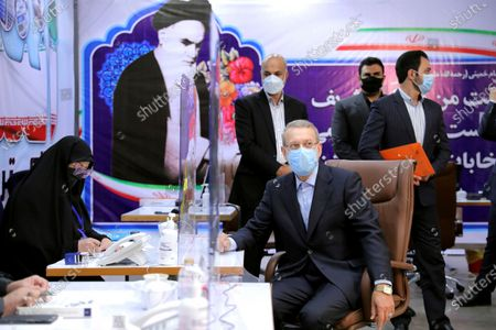 Former Iranian parliament speaker Ali Larijani, front right, registers his name as a candidate for the June 18 presidential elections at the interior Ministry in Tehran, Iran