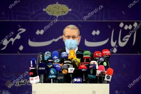 Former Iranian parliament speaker Ali Larijani attends a press conference after registering his candidacy for the June 18 presidential elections at the elections headquarters of the Interior Ministry in Tehran, Iran
