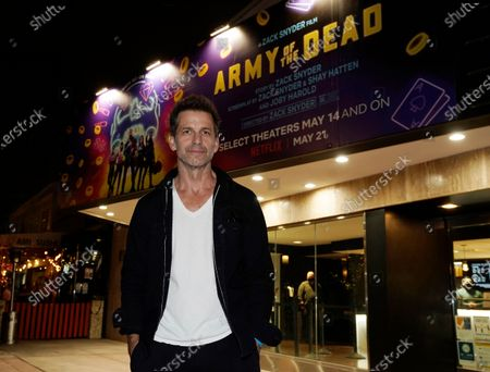 """Zack Snyder, director and co-screenwriter of the new film """"Army of the Dead,"""" poses before a screening of the film at the newly re-opened Landmark Westwood theater, in Los Angeles"""