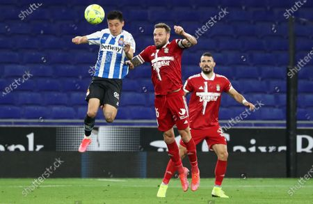 Wu Lei and Jose Angel Jurado during the match between RCD Espanyol and FC Cartagena, corresponding to the week 39 of the Liga Smartbank, played at the RCDE Stadium on 14th May 2021, in Barcelona, Spain.