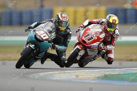 South African Moto3 rider Darryn Binder (L) of Petronas Sprinta Racing and Spanish Moto3 rider Sergio Garcia (R) of Gaviota GASGAS Aspar Team in action during the qualifying session for the French Motorcycling Grand Prix in Le Mans, France, 15 May 2021.