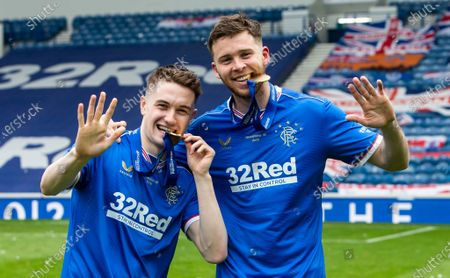 Stock Photo of Rangers Forward Scott Wright and Rangers Defender Jack Simpson celebrate after lifting the League Title