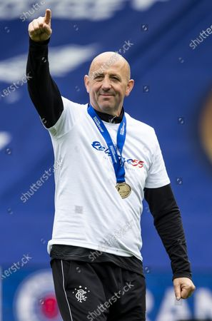 Stock Image of Rangers Assistant Manager Gary McAllister celebrates after lifting the league title