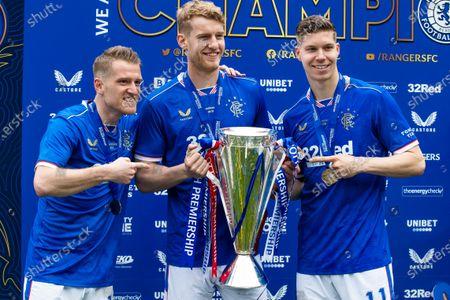 Stock Image of Steven Davis, Filip Helander and Cedric Itten of Rangers celebrate with the Scottish Premiership trophy at Ibrox Stadium.