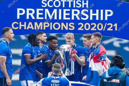 Rangers player Filip Helander celebrate with the Scottish Premiership trophy after Rangers clinched their 55th historic title.