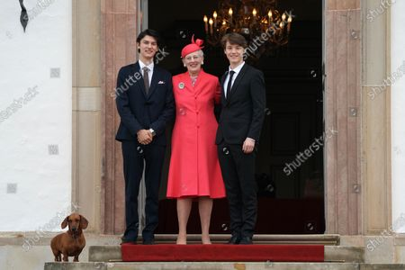 Denmark's Queen Margrethe II (C), Prince Nikolai (L) and Prince Felix pose as they arrive to Prince Christian's confirmation at Fredensborg Castle Church, in Fredensborg, Denmark, 15 May 2021. The ceremony is private with only 25 guests and presided by the Royal Confessor, Bishop Wigh-Poulsen. 15-year-old Prince Christian is the eldest child of Crown Prince Frederik and Crown Princess Mary.
