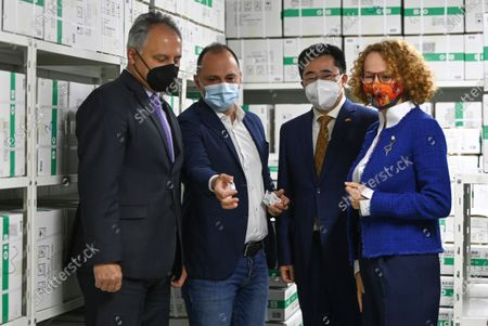 Macedonian Defense Minister Radmila Secerinska (R) and Minister of Health Venko Filpce (2-L) accompanied by Chinese Ambassador in North Macedonia Zhang Zuo (2-R) inspect the cold room full with 100,000 doses of the Sinopharm vaccine against COVID-19, donated by the Ministry of Defense of Republic of China at Polyclinic Jane Sandanski in Skopje, Republic of North Macedonia, 15 May 2021. The North Macedonia's authorities said that this donation will help to continue the mass vaccinations in the country.