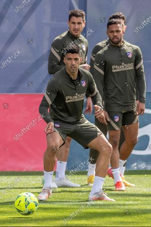 Atletico de Madrid players (L to R) Luis Suarez, Jose Maria Gimenez and Renan Lodi attend the team's training session hel at Wanda Sports City in Majadahonda, Madrid, Spain, 15 May 2021. Atletico de Madrid is facing Osasuna in a Spanish LaLiga soccer match on 16 May 2021.