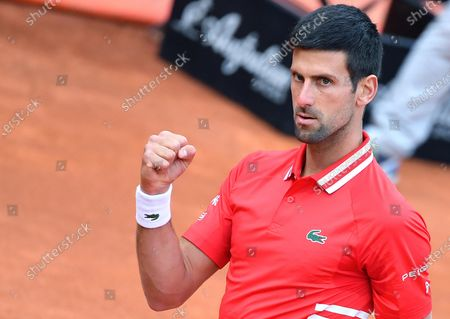 Novak Djokovic of Serbia reacts during his men's singles semi final match against Lorenzo Sonego of Italy at the Italian Open tennis tournament in Rome, Italy, 15 May 2021.