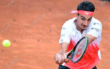 Lorenzo Sonego of Italy in action against Novak Djokovic of Serbia during their men's singles semi final match at the Italian Open tennis tournament in Rome, Italy, 15 May 2021.