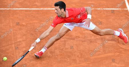 Novak Djokovic of Serbia in action against Lorenzo Sonego of Italy during their men's singles semi final match at the Italian Open tennis tournament in Rome, Italy, 15 May 2021.