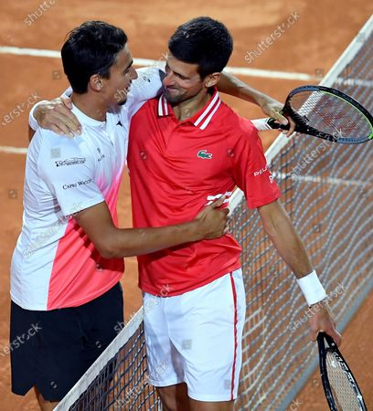 Novak Djokovic (R) of Serbia is congratulated by Lorenzo Sonego (L) of Italy after winning their men's singles semi final match at the Italian Open tennis tournament in Rome, Italy, 15 May 2021.