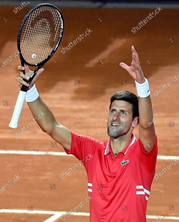 Novak Djokovic of Serbia celebrates after defeating Lorenzo Sonego of Italy in their men's singles semi final match at the Italian Open tennis tournament in Rome, Italy, 15 May 2021.