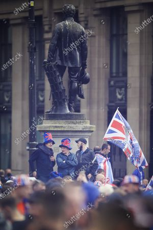 Rangers fans celebrate their club winning the Scottish Premiership for the first time in 10 years in George Square on May 15, 2021 in Glasgow, Scotland. Fans were warned to say away with lockdown restrictions still in place limiting the amount of people allowed to gather, Scottish First Minister Nicola Sturgeon and Police Scotland have both released statements urging fans to stay away from the planned celebrations.