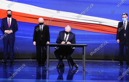 A photo taken from a webcast shows Leader of the Law and Justice (PiS) ruling party Jaroslaw Kaczynski (2L), Polish Prime Minister Mateusz Morawiecki (L), Jaroslaw Gowin, leader of the Agreement party (2R) and Polish Justice Minister and General Prosecutor Zbigniew Ziobro (R) during the presentation of the new program of the ruling Law and Justice party, in Warsaw, Poland, 15 May 2021. The leaders of the United Right signed a program declaration, the so-called 'New Deal plan', which in the post-pandemic period foresees more health spending and a bigger tax-free quota, Poland's ruling party Law and Justice (PiS) said at the plan's presentation.