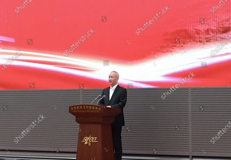 (210515) - BEIJING, May 15, 2021 (Xinhua) - Chinese Vice Premier Liu He, also a member of the Political Bureau of the Communist Party of China (CPC) Central Committee, reads out a congratulatory message from Chinese President Xi Jinping, at the Beijing Aerospace Control Center on May 15, 2021.  China's Mars probe Tianwen-1 successfully landed on the surface of the red planet on Saturday, leaving a Chinese footprint on Mars for the first time. On behalf of the Communist Party of China (CPC) Central Committee, the State Council and the Central Military Commission (CMC), Xi, general secretary of the CPC Central Committee and chairman of the CMC, extended warm congratulations and sincere greetings to all members who have participated in the Mars exploration mission, Tianwen-1, in a congratulatory message.