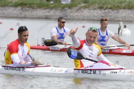Marcus Walz (R) and Rodrigo Germade (L) of Spain react after winning the men's K2 500m final of the ICF Canoe Sprint World Cup in Szeged, Hungary, 15 May 2021.
