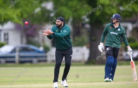 Ex-England International cricketer Monty Panesar playing for Twickenham Cricket Club while he studies for an MA in Sports Journalism at St Mary's University College, Twickenham. Here he receives the ball