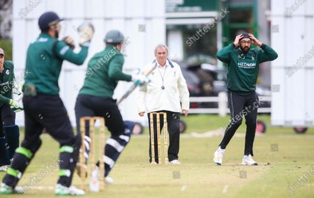 Stock Image of Ex-England International cricketer Monty Panesar playing for Twickenham Cricket Club while he studies for an MA in Sports Journalism at St Mary's University College, Twickenham. Bowling and frustrated