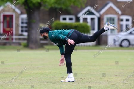 Ex-England International cricketer Monty Panesar playing for Twickenham Cricket Club while he studies for an MA in Sports Journalism at St Mary's University College, Twickenham. Here stretching