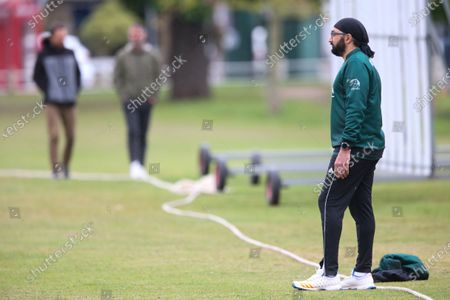 Ex-England International cricketer Monty Panesar playing for Twickenham Cricket Club while he studies for an MA in Sports Journalism at St Mary's University College, Twickenham. Here fielding on the boundary
