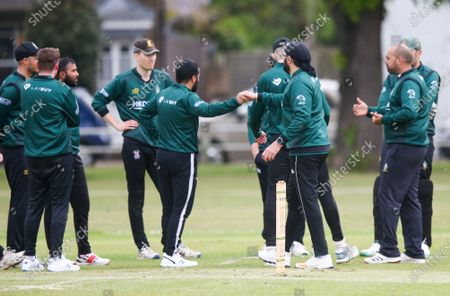 Ex-England International cricketer Monty Panesar playing for Twickenham Cricket Club while he studies for an MA in Sports Journalism at St Mary's University College, Twickenham. Here fist bumps after a wicket (not his)
