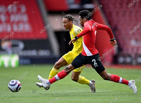 Southampton's Kyle Walker-Peters, front, duels for the ball with Fulham's Bobby Decordova-Reid during the English Premier League soccer match between Southampton and Fulham at St. Mary's Stadium in Southampton, England